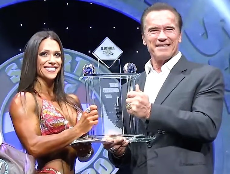 Oksana Grishina with Arnold Schwarzenegger at 2014 Classic
